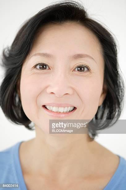 Portrait of woman, close-up, studio shot