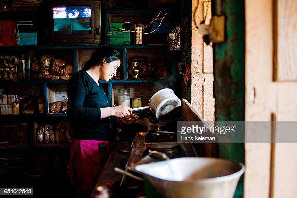 Portrait of woman cooking