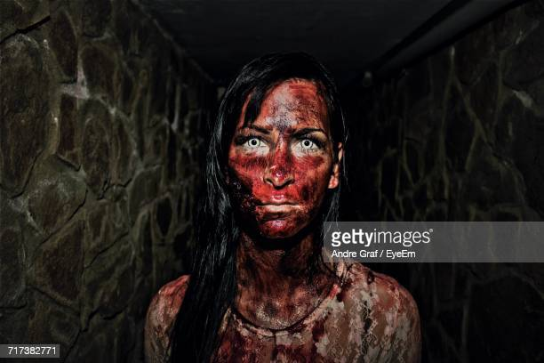 portrait of woman covered in blood - zombie makeup stock photos and pictures