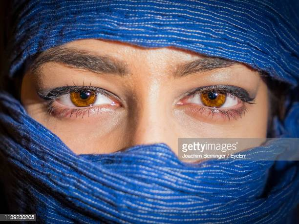 portrait of woman covering face with scarf - brown eyes stock pictures, royalty-free photos & images