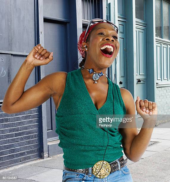 portrait of woman dancing and singing - singer stock pictures, royalty-free photos & images