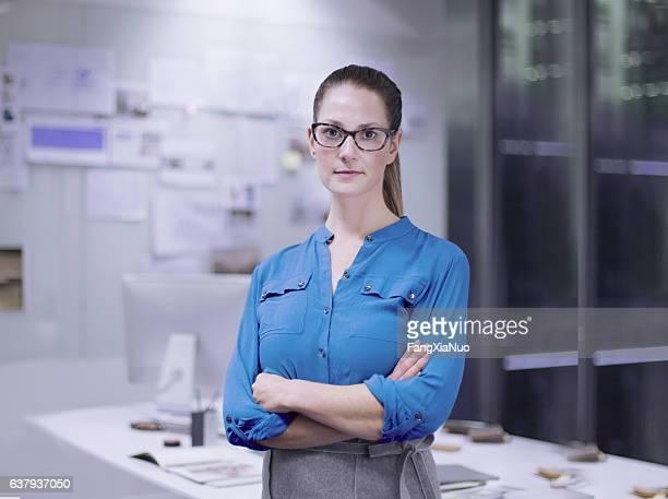 Portrait of woman designer in studio office