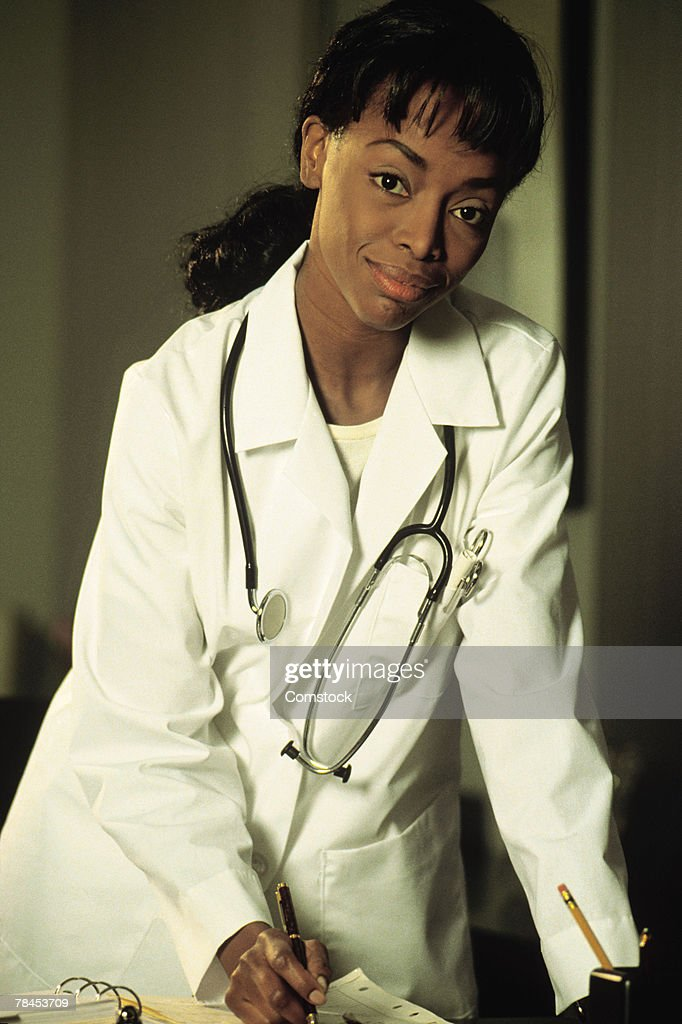 Portrait of woman doctor at her desk : Stockfoto