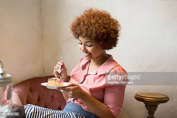Portrait of woman eating cake