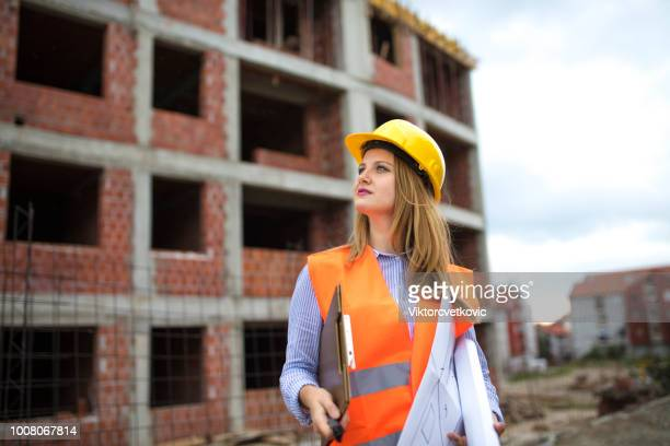 Portrait of woman engineer at construction site
