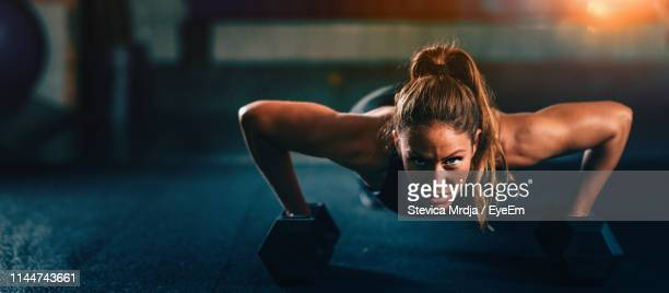 portrait of woman exercising at gym - adults only stock pictures, royalty-free photos & images