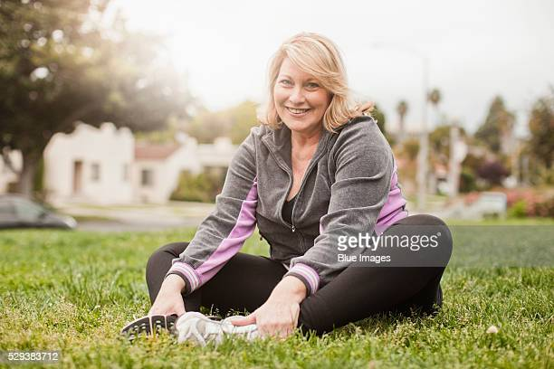 portrait of woman exercising on lawn - chubby stock pictures, royalty-free photos & images