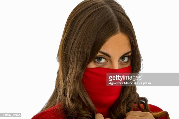 portrait of woman face covered with textile against white background - obscured face stock pictures, royalty-free photos & images