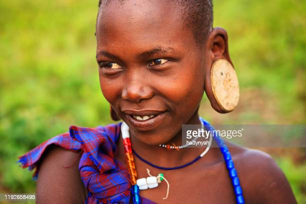 portrait of woman from mursi tribe, ethiopia, africa - east african tribe stock pictures, royalty-free photos & images