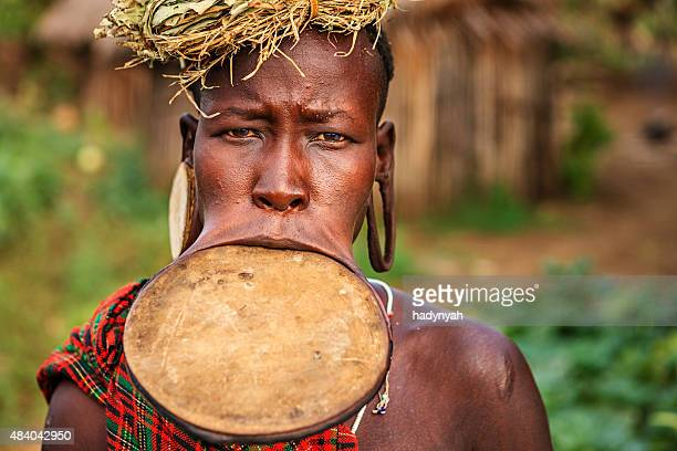 portrait of woman from mursi tribe, ethiopia, africa - lip plate stock photos and pictures