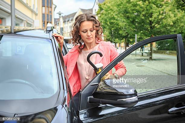 Portrait of woman getting on her car