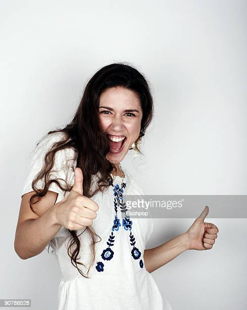 Portrait of woman giving the thumbs up