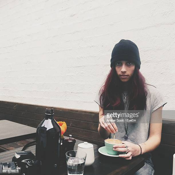 Portrait Of Woman Having Coffee While Sitting At Cafe