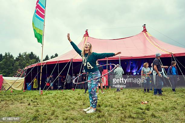 portrait of woman having fun at a music festival - music festival stock pictures, royalty-free photos & images