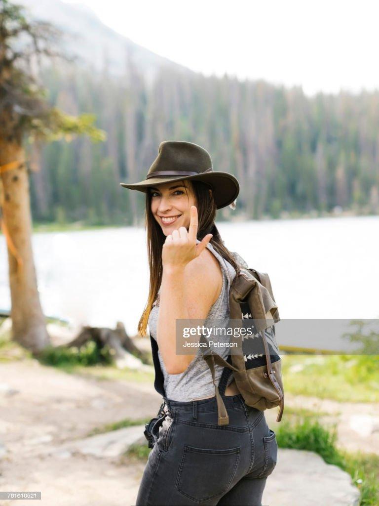 Portrait of woman hiking by lake : Stock Photo