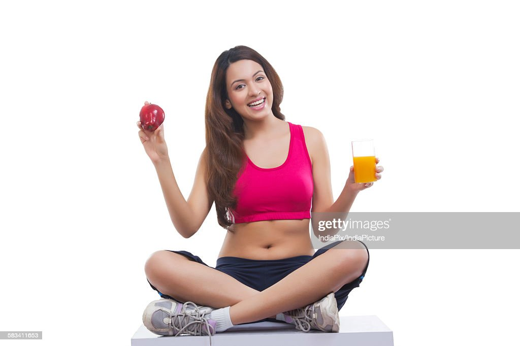 Portrait of woman holding apple and juice : Stock Photo