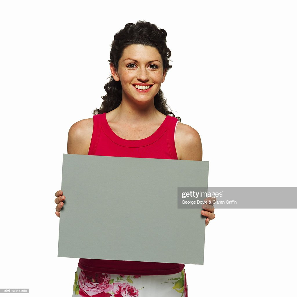 Portrait of woman holding blank card : Stock Photo