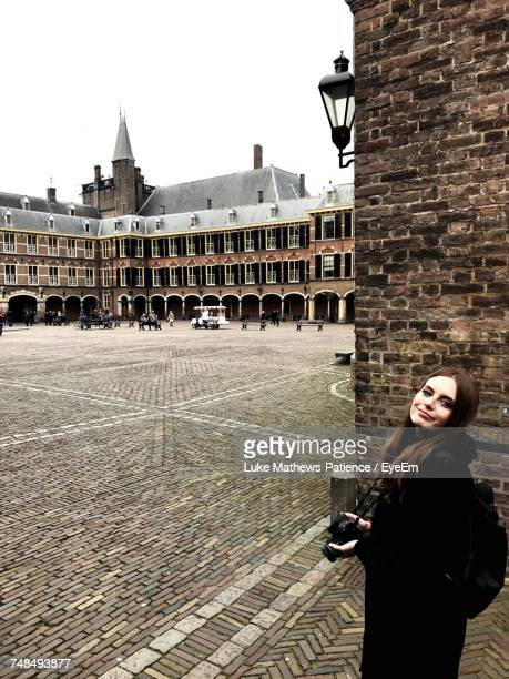 Portrait Of Woman Holding Camera While Standing At Binnenhof