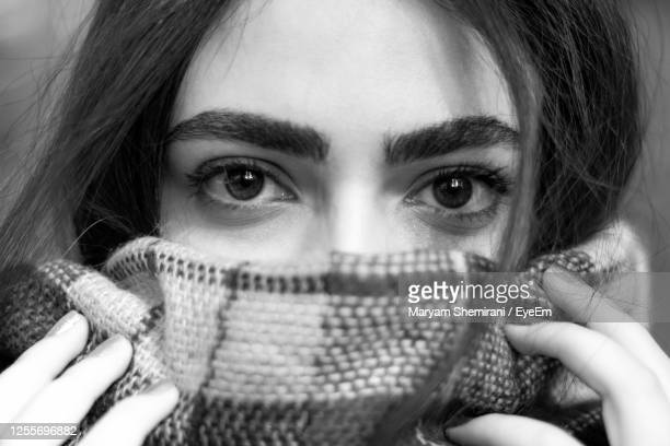 portrait of woman holding covering face - iran stock pictures, royalty-free photos & images
