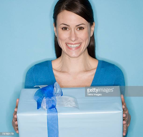 Portrait of woman holding gift