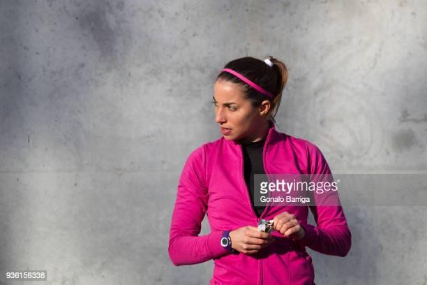portrait of woman holding protein bar looking away - barra de chocolate imagens e fotografias de stock