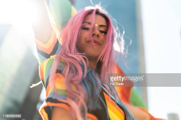 portrait of woman holding rainbow flag during lgbtqi - equality stock pictures, royalty-free photos & images