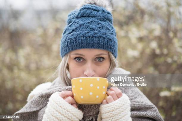 Portrait Of Woman Holding Tea Cup