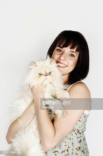 Portrait of woman hugging her pet