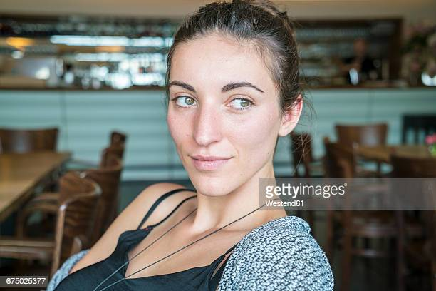 portrait of woman in a coffee shop - one young woman only stock pictures, royalty-free photos & images