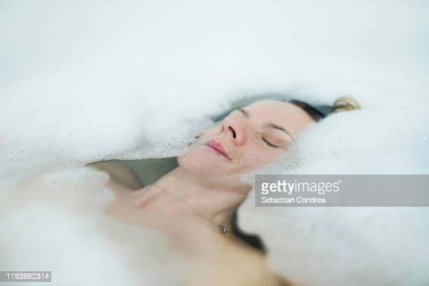 portrait of  woman in bathtub with bubble. - leaning disability stock pictures, royalty-free photos & images