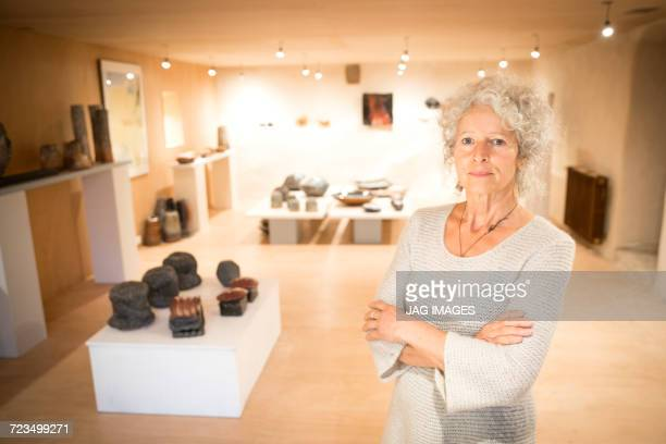 Portrait of woman in ceramics gallery