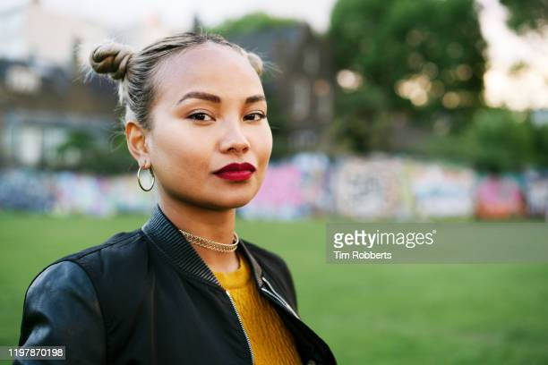 portrait of woman in city park - red lipstick stock pictures, royalty-free photos & images