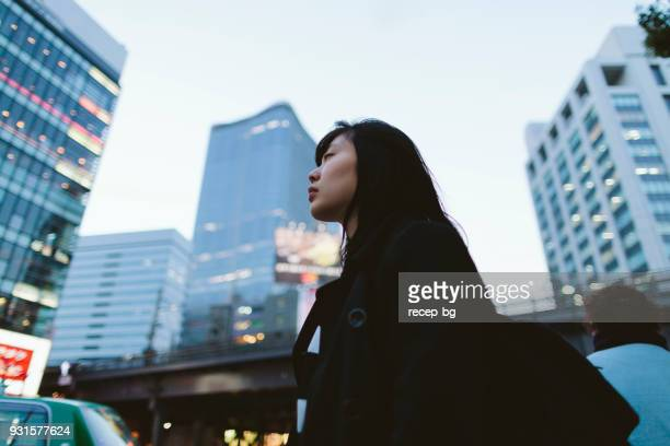 portrait of woman in city - solitude stock pictures, royalty-free photos & images