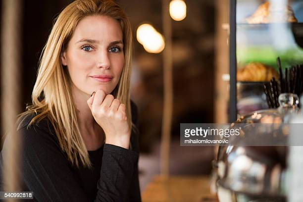Portrait of woman in coffee shop