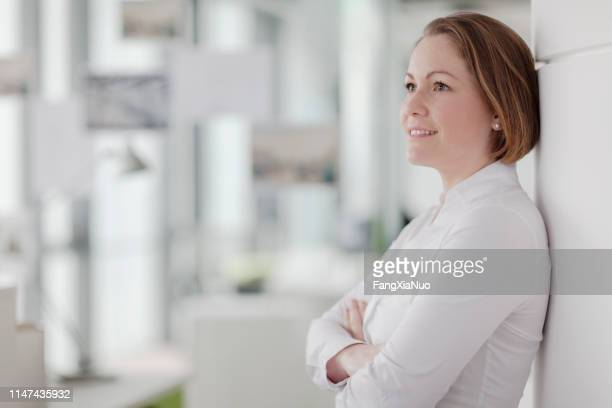 portrait of woman in design office work studio - museum curator stock pictures, royalty-free photos & images