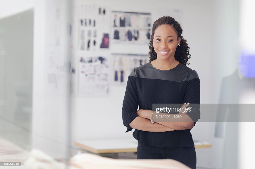 Portrait of woman in fashion design studio : Stock Photo