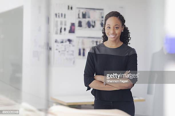 Portrait of woman in fashion design studio
