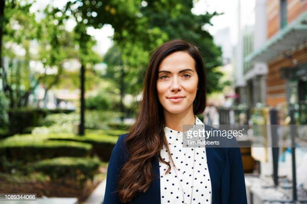 portrait of woman in financial district - one young woman only stock pictures, royalty-free photos & images