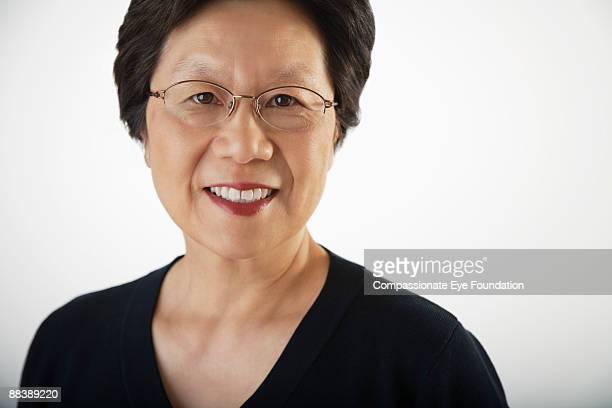 "portrait of woman in glasses - ""compassionate eye"" imagens e fotografias de stock"
