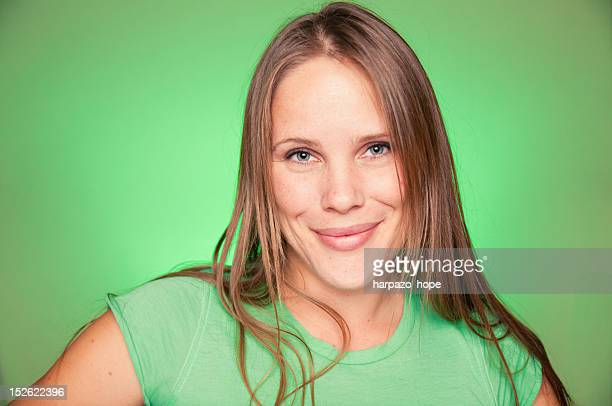 portrait of woman in green - green background stock pictures, royalty-free photos & images