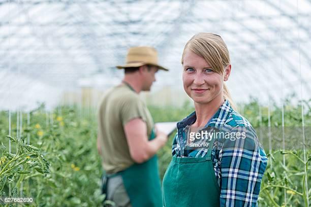 Portrait of woman in greenhouse