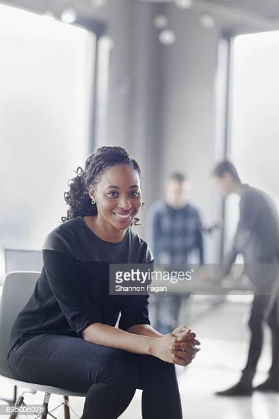 Portrait of woman in group meeting design studio
