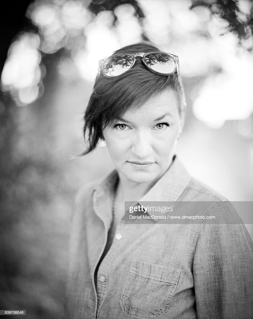 Portrait Of Woman In Her 40s With Stylish Haircut And Sunglasses On