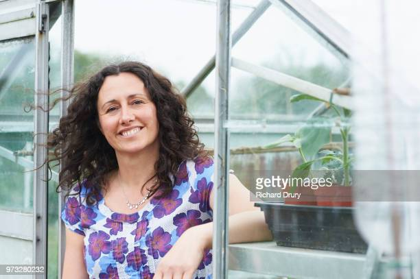 Portrait of woman in her greenhouse