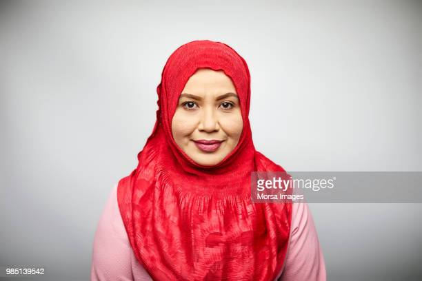 portrait of woman in hijab on white background - malay hijab stock photos and pictures
