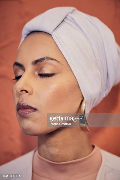 Portrait of woman in hijab with her eyes closed