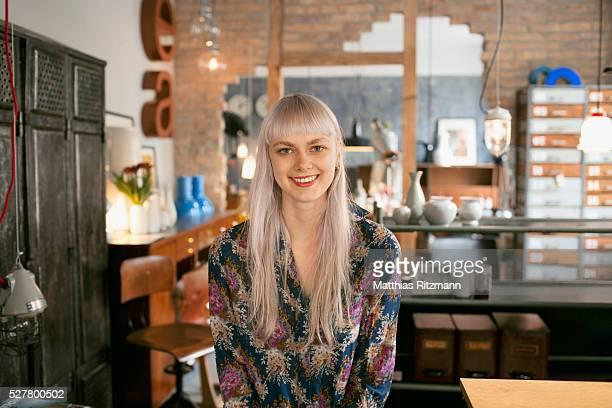 Portrait of woman in home decor shop