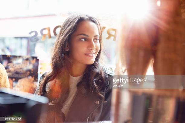 portrait of woman in ice cream cafe - china: through the looking glass bildbanksfoton och bilder