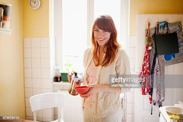 Portrait of woman in kitchen