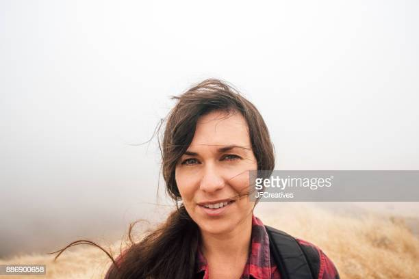 Portrait of woman in misty field looking at camera smiling, Fairfax, California, USA, North America